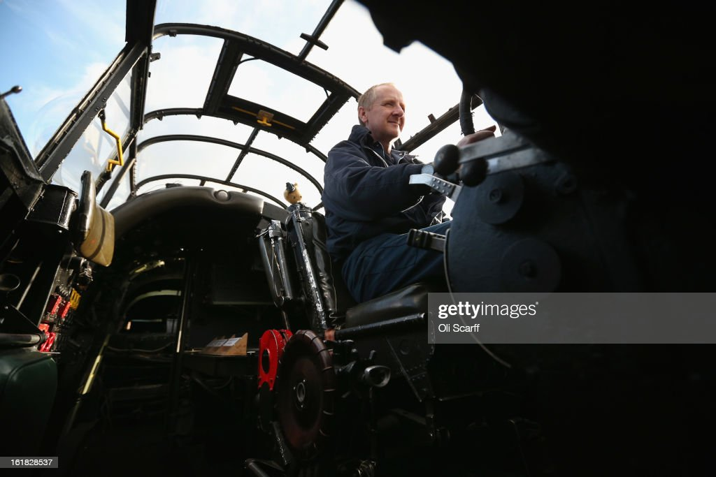 Engineer Keith Breachley in the cockpit of the Lancaster bomber 'Just Jane' which is being restored with the aim of getting it airworthy, at Lincolnshire Aviation Heritage Centre, on February 14, 2013 in East Kirkby, England. The plane, which last flew in 1971, would become one of only three airworthy Lancaster bombers in the world. Brothers Fred and Harold Panton, owners of the Lincolnshire Aviation Heritage Centre, are restoring the plane in memory of their sibling, Christopher Panton, who died aged 19 when his Lancaster was shot down in 1944.