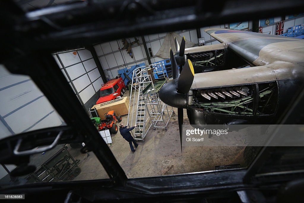 Engineer Keith Breachley works on the Lancaster bomber 'Just Jane' , with the aim of getting it airworthy, at Lincolnshire Aviation Heritage Centre on February 14, 2013 in East Kirkby, England. The plane, which last flew in 1971, would become one of only three airworthy Lancaster bombers in the world. Brothers Fred and Harold Panton, owners of the Lincolnshire Aviation Heritage Centre, are restoring the plane in memory of their sibling, Christopher Panton, who died aged 19 when his Lancaster was shot down in 1944.