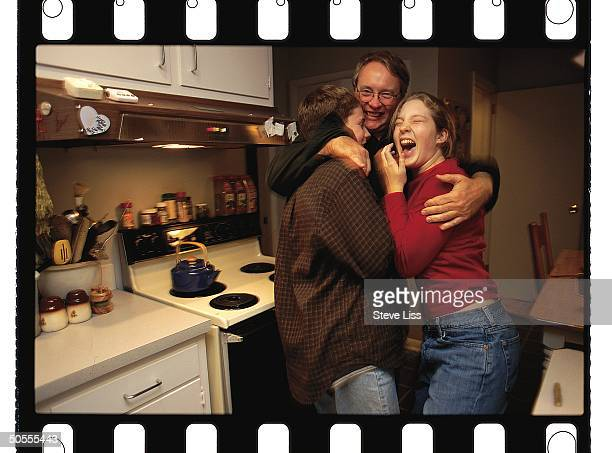 Engineer Louis Licht hugging his son Rustin daughter Alex re his discovery that poplar trees when planted near rivers or streams absorb significant...