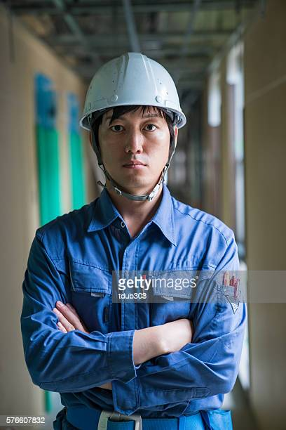 Engineer or inspector at building construction site