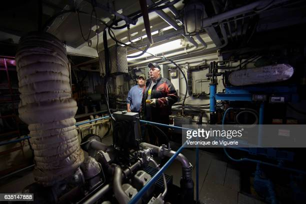Engineer Philip Kennedy and Captain Ed Kean the machines room of the Green Waters As more icebergs drift south due to climate change a few...