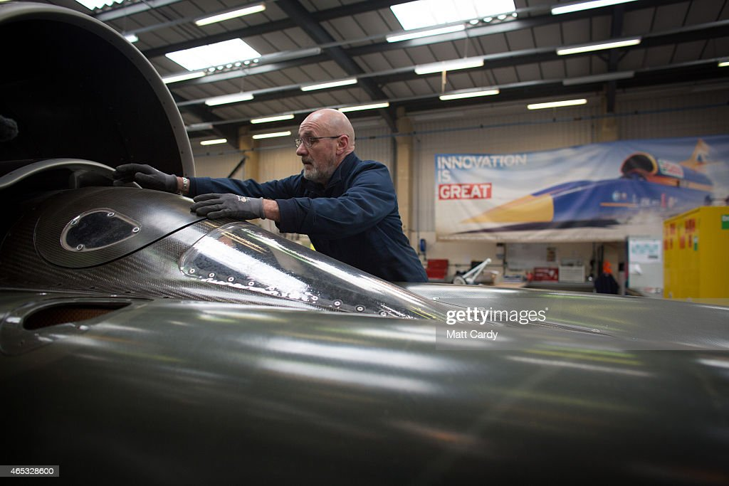 A engineer places the cockpit cover as he works on the carbonfibre body of the Bloodhound SSC vehicle currently taking shape at its design centre in...