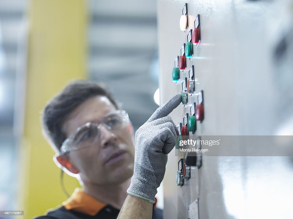 Engineer pressing button in engineering factory