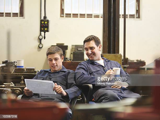 Engineer Relaxing With Apprentice