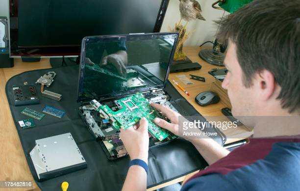 Engineer Repairing a Laptop