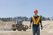 Engineer standing at a gravel and asphalt plant