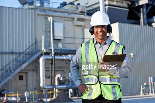 Engineer standing in front of power generator