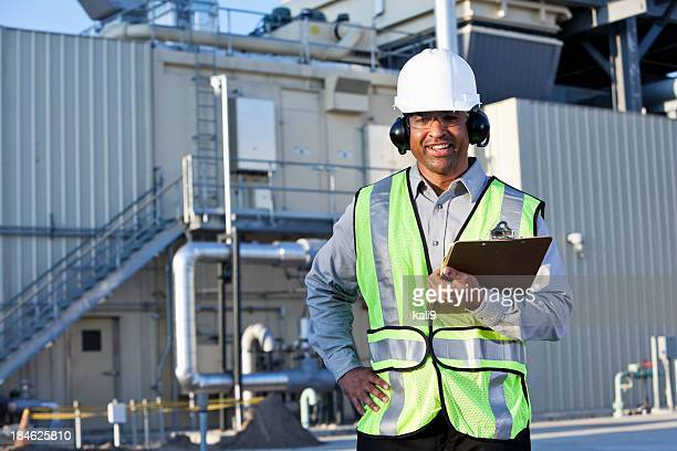 Engineer standing in front of power generator