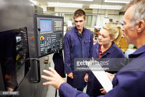 Engineer Students Learn to Use Computerized Lathe : Stock Photo