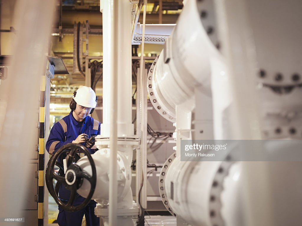 Engineer taking reading in power station