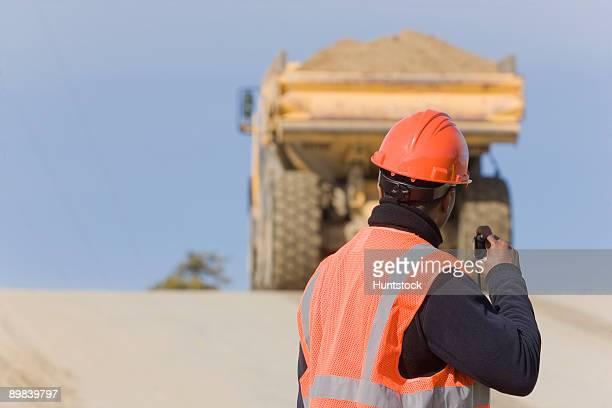 Engineer talking on a walkie-talkie