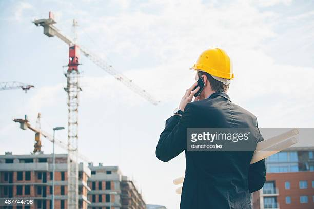 Engineer talking on smart phone at construction site