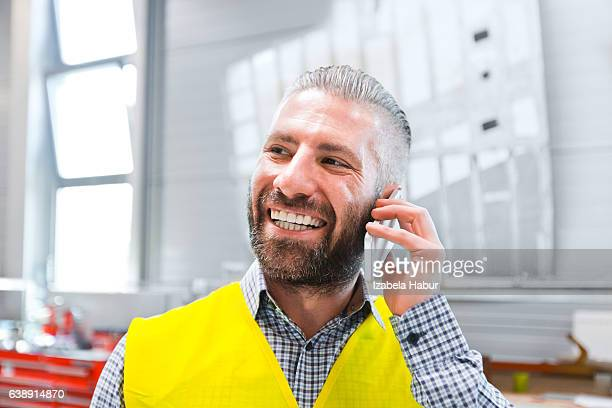 Engineer talking on smart phone at work