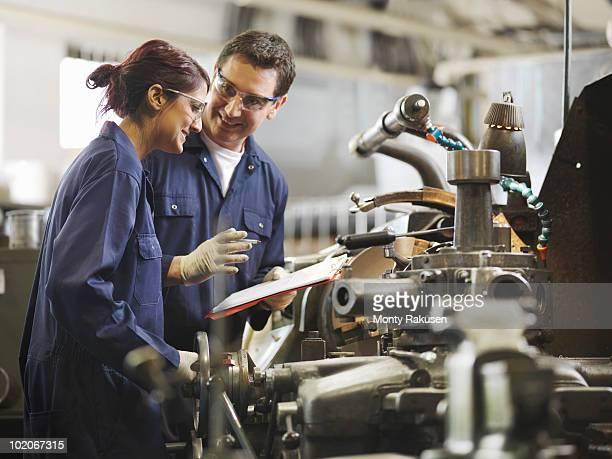 Engineer Teaching Female Apprentice