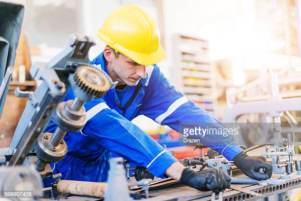 Engineer testing the main production line in factory