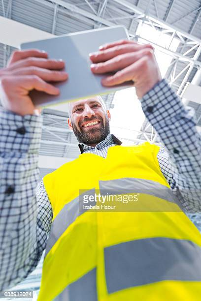 Engineer using a digital tablet, low angle view