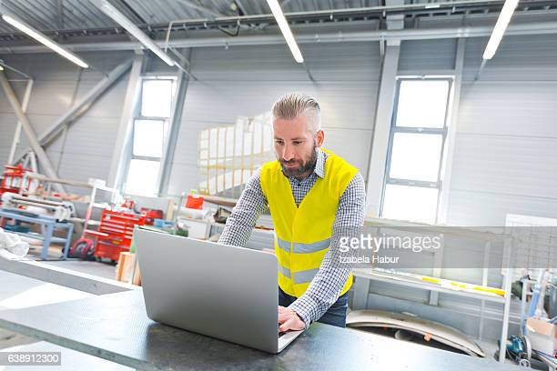 Engineer using a laptop at work