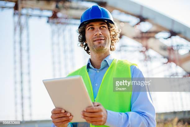 Engineer using digital tablet on construction site
