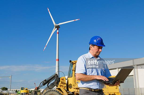 Engineer Using PC in a Wind Turbine Farm