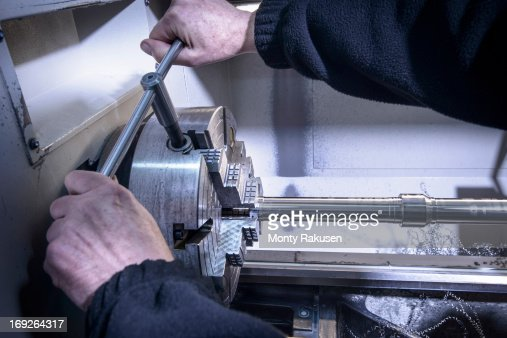 steel lathe engineer operating industrial steel lathe stock photo getty images