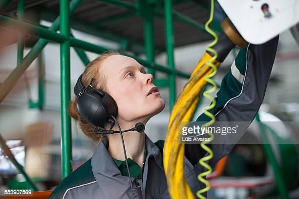 Engineer wearing ear protectors in hangar