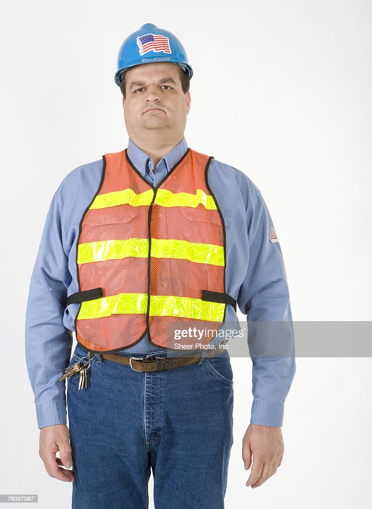 Engineer wearing hard hat and safety vest, portrait : Stock Photo