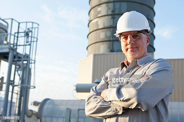 Engineer wearing hardhat at industrial facility