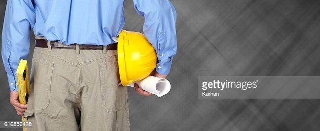 Engineer with helmet and blueprint. : Stock Photo