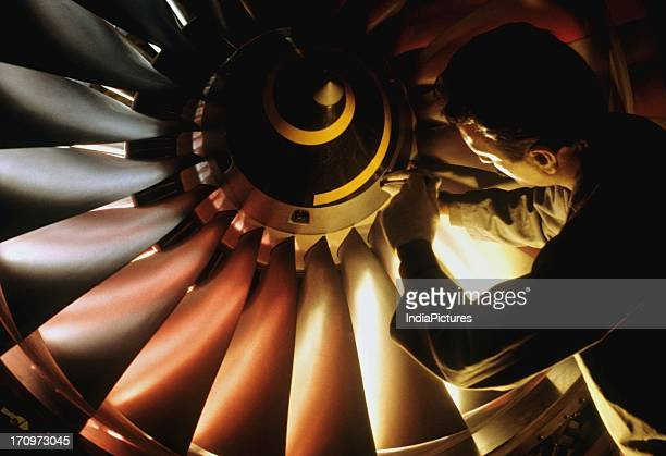 Engineer working on turbine of the aircraft India
