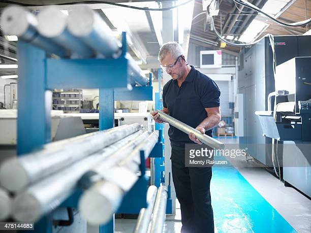 Engineer working with aluminium in factory