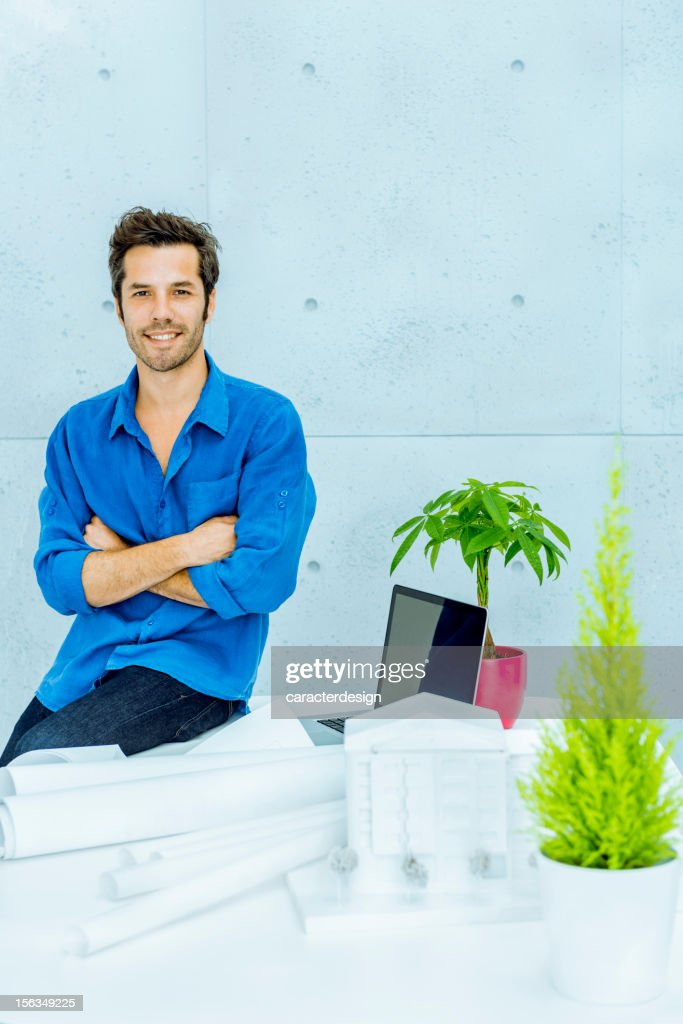 Engineer working with blueprints : Stock Photo