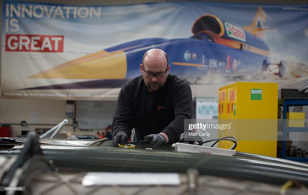 A engineer works on a carbonfibre body panel of the Bloodhound SSC vehicle currently taking shape at its design centre in Avonmouth on March 5 2015...