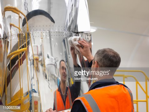 Engineer works on jet aircraft