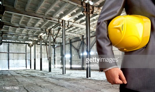 engineer yellow helmet for workers security against the support : Stock Photo