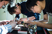 engineering students assembling robotic car