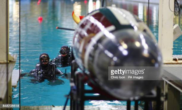 Engineering students from Texas AM University wait as their human powered submarine Maroon Harpoon is lowered into the water before racing at...