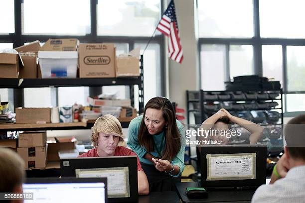 Engineering teacher Cheryl Beauchamp helps student Knightly Duggar during class at Coronado High School on Tuesday October 21 2014 in Coronado CA...