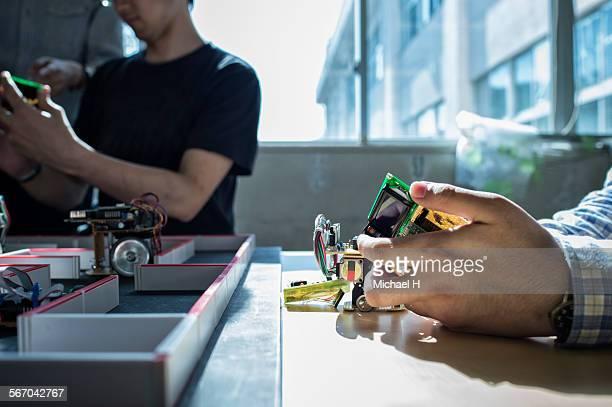 engineers assembling robotic car