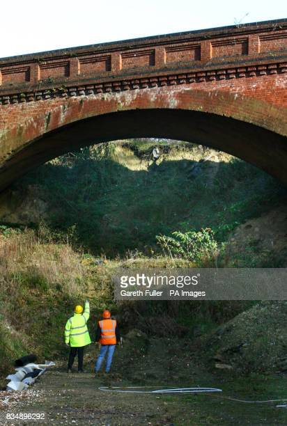 Engineers assess a railway bridge in the Imberhorne Cutting in East Sussex as work starts on removing thousands of tonnes of waste dumped in the...