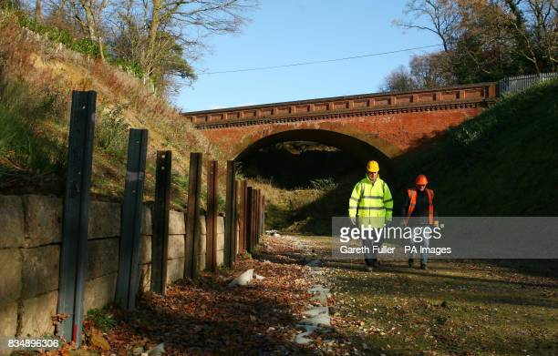 Engineers assess the Imberhorne Cutting in East Sussex as work begins to excavate thousands of tonnes of waste dumped there in the 1960's This will...