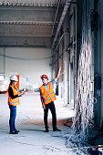Engineers checking progress on electric installation setup