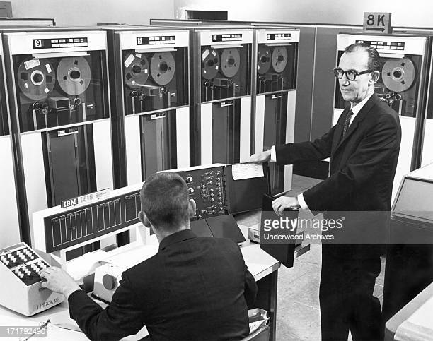 Engineers at the GMC Truck Division use an IBM digital computer in place of field tests to evaluate braking systems Pontiac Michigan circa 1962