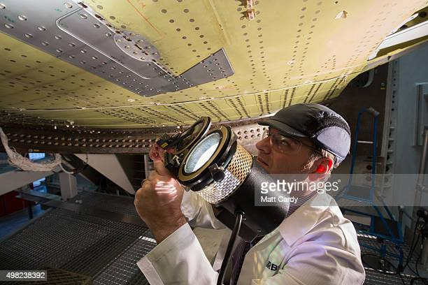 Engineers conduct a fatigue test on part of a Airbus A320 wing on a test rig at the Airbus aircraft manufacturer's Filton site on November 19 2015 in...