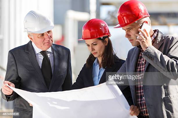Engineers discussing at industrial facility