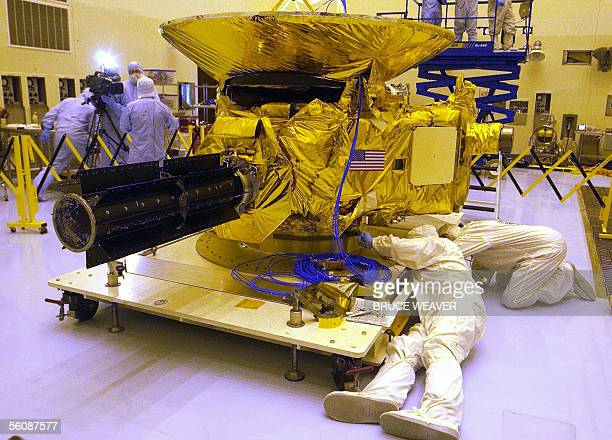 Engineers from Johns Hopkins University check out NASA's New Horizons spacecraft 04 November 2005 in the Payload Hazardous Servicing Facility at...