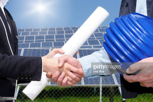 Engineers Handshaking in a Solar Power Station