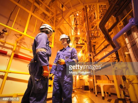 Engineers in meeting near reactor hall of nuclear power station : Stock Photo
