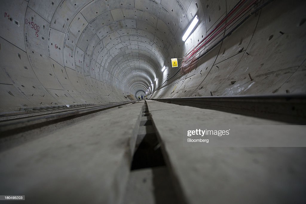 Engineers inspect a finished section of the Tunnel Emisor Oriente (TEO), or Eastern Discharge Tunnel, during construction of the 38 mile (62km) underground wastewater treatment tunnel in Mexico City, Mexico, on Thursday, Sept. 12, 2013. The tunnel, which is expected to be completed in 2014, will boost Mexico City's drainage capacity to help prevent flooding during rainy season and the over-exploitation of groundwater resources. The project is being managed by Mexico's National Water Commission, Conagua. Photographer: Susana Gonzalez/Bloomberg via Getty Images