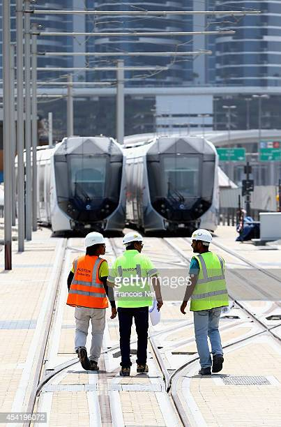 Engineers inspect tracks at the Al Sufouh depot on August 26 2014 in Dubai United Arab EmiratesThe first phase of the Dubai Tram network is expected...
