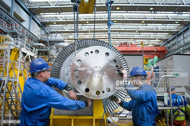 Engineers inspecting turbine during power station outage